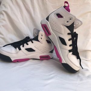 Pink and white Jordan shoes